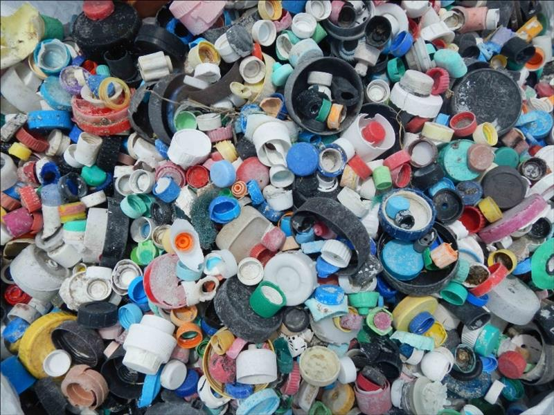 This photo, taken after a 21-day marine debris removal effort by the PIFSC, shows 4,781 bottle caps collected from Midway Atoll's shoreline. Most plastic bottle caps are made from polypropylene, also known as plastic #5, a hard, durable plastic - photo © NOAA Fisheries / PIFSC