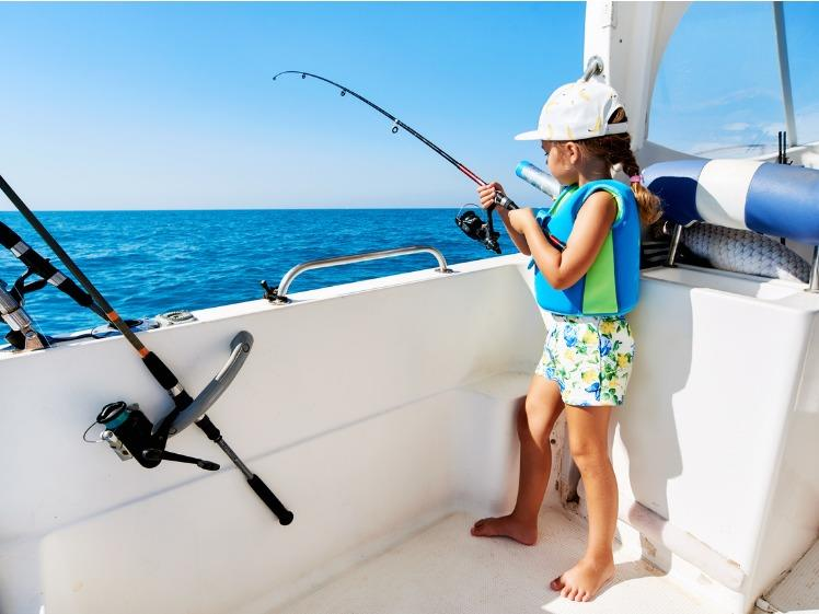 A beginner setting up a fishing rod and casting off a boat photo copyright Boat Accessories Australia taken at  and featuring the Fishing boat class