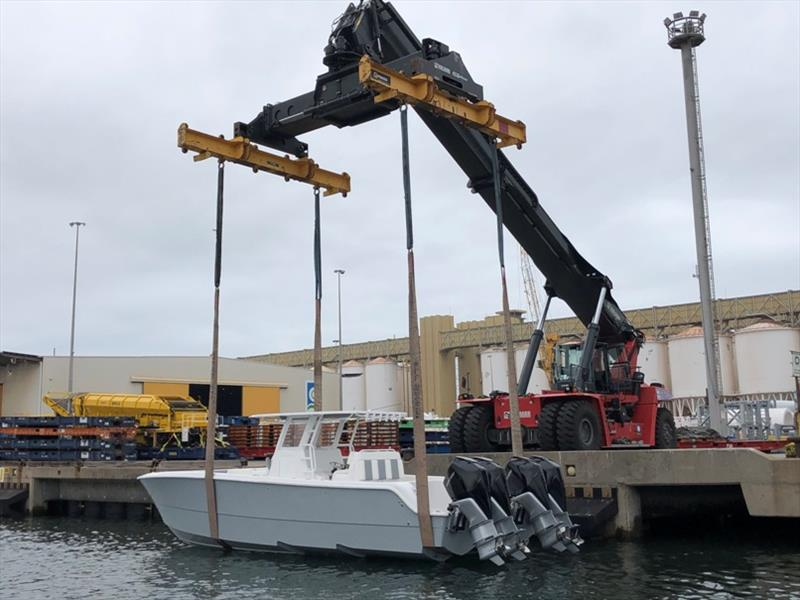 Invincible 35' Catamaran gets lifted from the RoRo into Australian waters - stern photo copyright Boat Monster taken at  and featuring the Fishing boat class