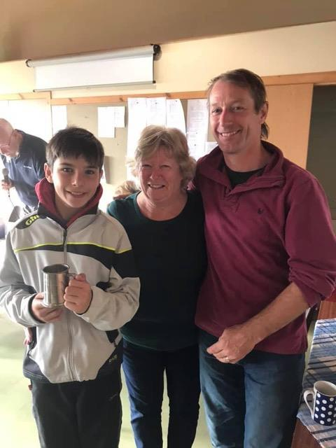"Tim and Christopher Hampshire, proud winners of the Admiral's Cup ""Mariner Mug"", presented by Jacquie Tosh, wife of Club commodore Lindsay during the Solway Yacht Club Championship weekend photo copyright Anne-Marie Williams taken at Solway Yacht Club"