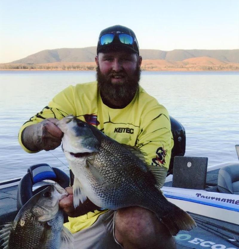 Aussie angler Daniel McCoy caught and released 4.45-kg Australian bass (Macquaria novemaculeata) on August 18, 2018 while fishing Lake Somerset in QLD, Australia. McCoy played fish for 15 minutes on 6-pound test line after it hit lure he was casting. - photo © IGFA