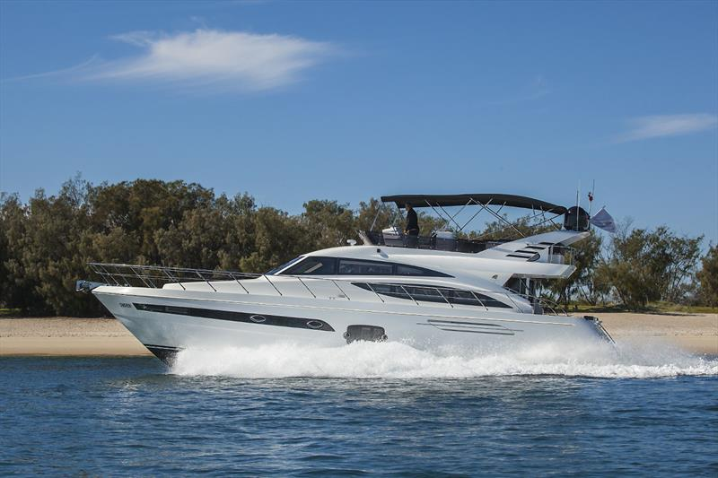 Elegant lines of the Longreef 60 SX are great stationery and under way - photo © John Curnow