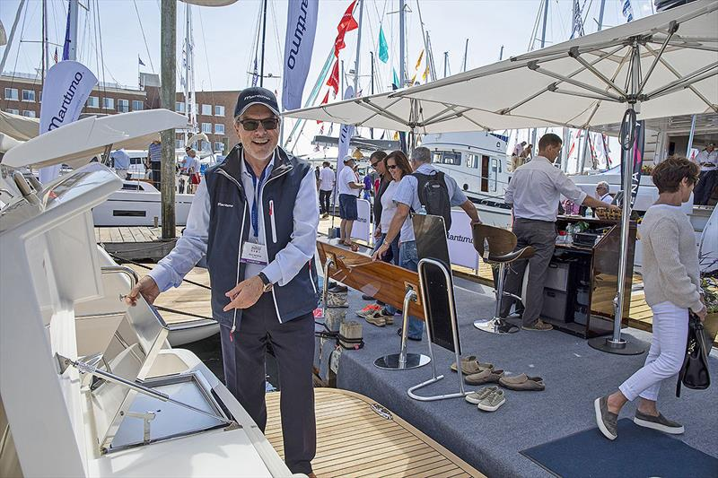 Maritimo America's President, Dave Northrop, proudly displaying the vessels at the Newport show - photo © Billy Black