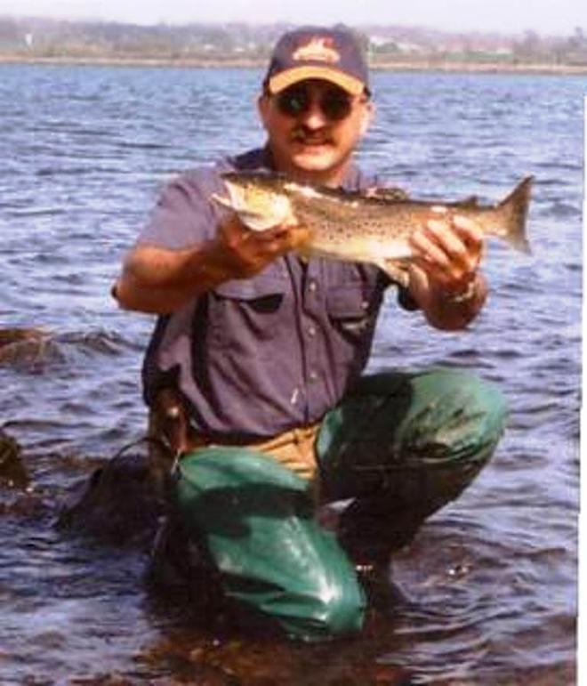 The author with a sea run trout from the Tamar River taken on lure. © Carl Hyland